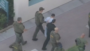 Police surround Nikolas Cruz who is suspected of carrying out the shooting