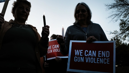 People in Newtown, Connecticut, take part in a vigil against gun violence