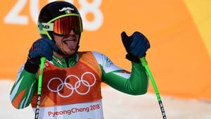 Ireland's Patrick McMillan reacts after crossing the finish line of the men's downhill at the Winter Games