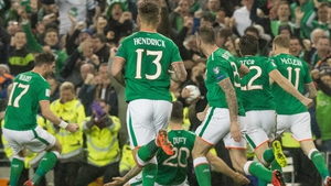 Ireland players celebrate with Shane Duffy after his goal against Denmark in the World Cup play-off at the Aviva Stadium