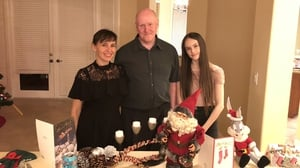 Olga Hurley (L) with her husband and daughter Adelina, who was in the school when the mass shooting occurred