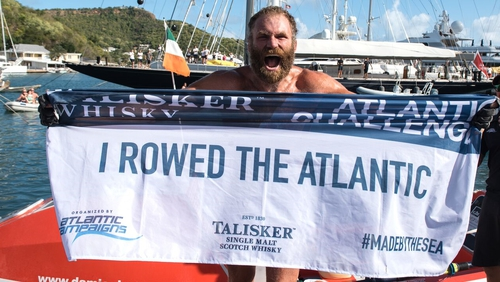 Damian Browne celebrates arriving in Antigua, 64 days after setting off from the Canary Islands