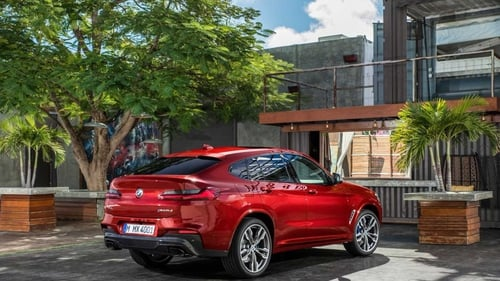 The new BMW X4 combines SUV looks with a coupe profile.