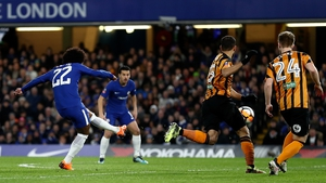 Willian of Chelsea fires home the opening goal