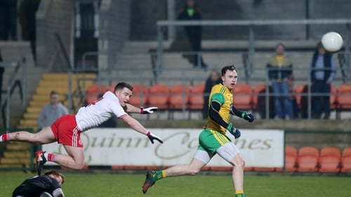Donegal's Martin McElhinney chips Tyrone goalkeeper Mickey O'Neill to score a goal