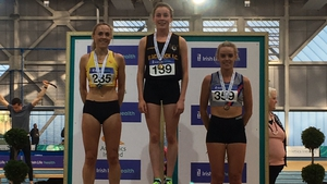 Sarah Healy on the podium with Kerry O'Flaherty (L) and Meghan Ryan (R)