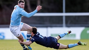 Garryowen's James McInerney is tackled by Rory Mulvihill of UCD