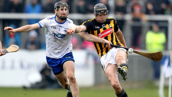 Kilkenny forward Walter Walsh kicks the sliother under pressure from Waterford full-back Barry Coughlan
