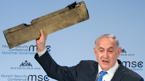 Benjamin Netanyahu, showing a piece of an allegedly Iranian drone shot down over Israel, at the Munich Security Conference