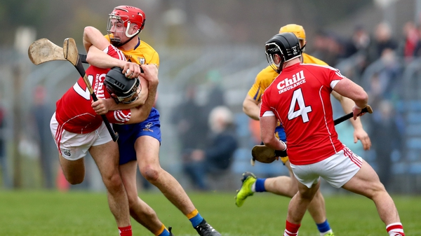 Cork's Christopher Joyce and Peter Duggan of Clare in a battle for possession at Cusack Park