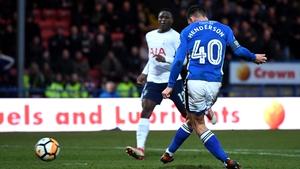 Ian Henderson scores against Tottenham