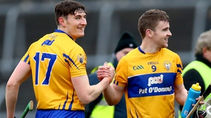 Clare's David Fitzgerald and Tony Kelly celebrate their defeat of Cork