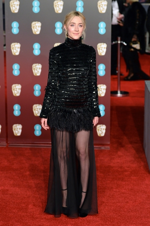 Pictured in London at the Baftas in a Chanel dress and Jimmy Choo shoes, along with Cartier jewel-encrusted drop earrings.