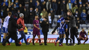 Sergio Aguero walks from the pitch after Mancehster City lost 1-0 to Wigan in the FA Cup tonight