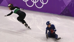Elise Christie of Great Britain crashes during the Ladies Short Track Speed Skating 1000m Heats