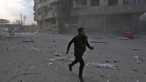 Syria: scores of civilians killed in government air strikes