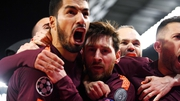 Luis Suarez swamps Leo Messi after his crucial leveller at Chelsea