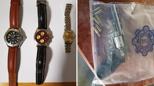Designer watches and an imitation gun seized in the searches
