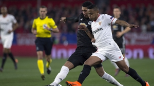 Chris Smalling (L) battles with Sevilla's Colombian forward Luis Muriel