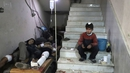 Wounded Syrians wait to receive treatment at a makeshift hospital in Eastern Ghouta