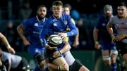Leinster's Garry Ringrose is tackled by Eital Bredenkamp