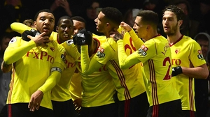 Troy Deeney is mobbed by his Watford team-mates