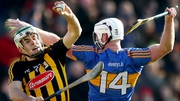 Kilkenny's Paddy Deegan and Michael Breen of Tipperary battle for possession
