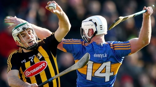 Kilkenny's Paddy Deegan and Michael Breen of Tipperary compete for the ball