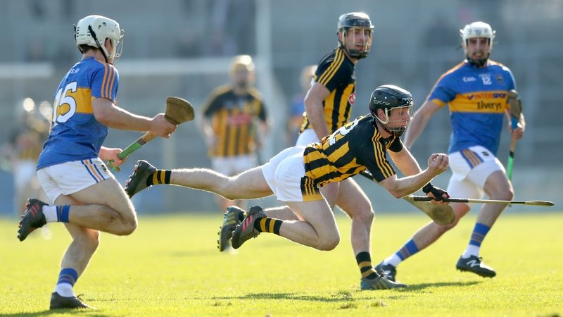 Tipperary's Niall O'Meara goes to tackle Enda Morrissey in today's classic encounter in Nowlan Park