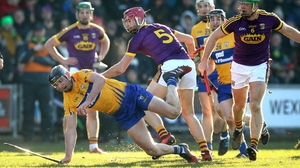 Wexford's Paudie Foley and Michael O'Malley of Clare in action