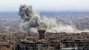 Smoke rises from the rebel-held enclave of Eastern Ghouta