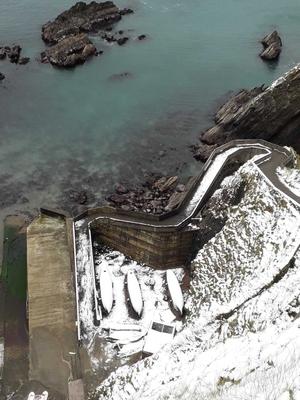 Dunquin Pier from above. By Fergal O'Slattara
