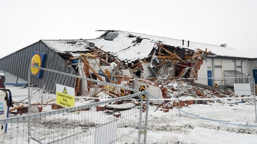 A Lidl supermarket was looted and bulldozed with a digger