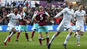 Mike van der Hoorn of Swansea City celebrates scoring his side's second goal