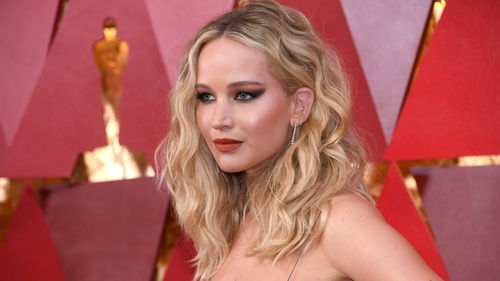 The stars walk the red carpet at the 90th Academy Awards
