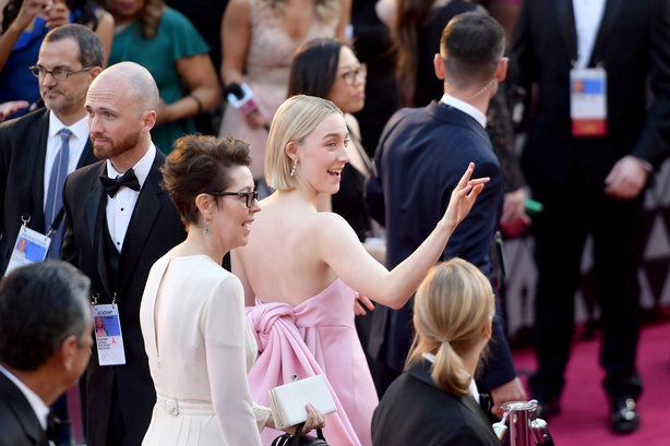 Saoirse Ronan pictured with her Mum Marian on the red carpet waving at fans