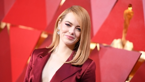 Emma Stone surprises on the Oscars red carpet