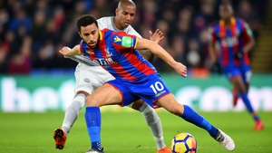 Crystal Palace's Andros Townsend holds off Ashley Young
