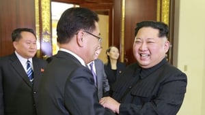 North Korean leader Kim Jong-un (R) greeting a South Korean delegation in Pyongyang earlier this month