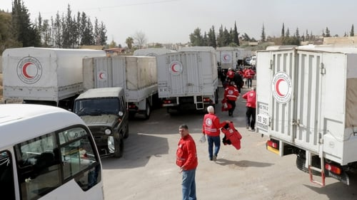 Volunteers of the Syrian Red Crescent are seen ahead of their mission to Eastern Ghouta on Monday