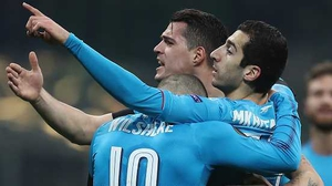 Henrikh Mkhitaryan is mobbed after his opener against AC Milan