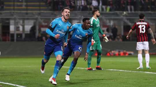 Aaron Ramsey celebrates his first half goal in Arsenal's 2-0 win away to AC Milan