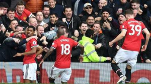 Marcus Rashford celebrates his opener with the fans