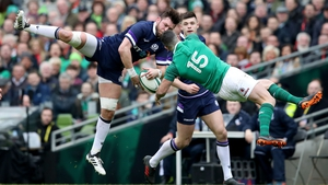 Scotland's Ryan Wilson and Ireland's Rob Kearney competing for the ball