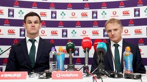 Jonathan Sexton (L) and Joe Schmidt speak to the media after confirmation Ireland are the new champions