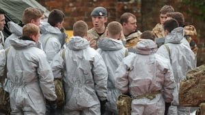 Military personnel in protective clothing prepare to remove vehicles from a car park in Salisbury, England, today