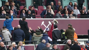 West Ham owner David Gold (far right) tries to ignore protesting fans gathering on the concourse below during the Premier League match between West Ham United and Burnley