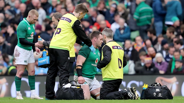Cian Healy receives medical treatment on the pitch against Scotland