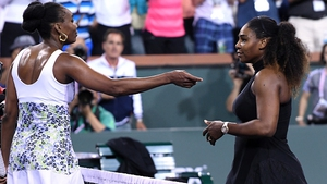 Serena Williams, right, congratulates Venus on her victory last week
