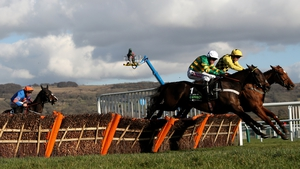 Buveur D'Air and Melon clear the last in the Champion Hurdle